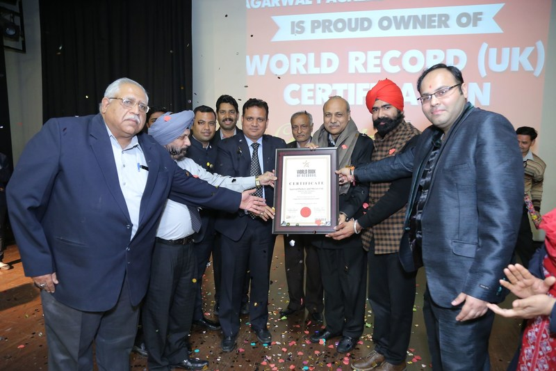 Marking the occassion of Agarwal Packers and Movers Limited being bestowed the certification by World Book of Records, London, UK, Shri Ramesh Agarwal was congratulated by Shri Virendra Sharma (Member of British Parliament), Dr. Diwakar Sukul (Chairman of World Book of Records London) and Shri Santosh Shukla, Advocate (President, World Book of Records, India). (PRNewsfoto/Agarwal Packers and Movers Ltd.)