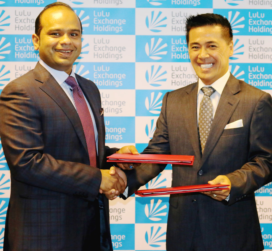 Adeeb Ahamed, Managing Director, LuLu Exchange Holdings with Ralph Santos, CEO, ARKIN Technologies LTD. after signing the partnership deal in Abu Dhabi (PRNewsfoto/LuLu Exchange)