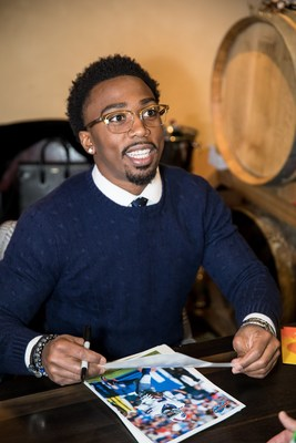Tyrod Taylor signing autographs at the recent FrameGenie T2 launch party.