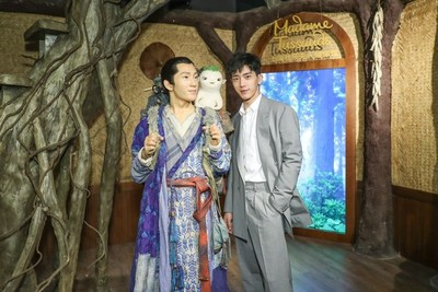 "Jing Boran interacted with his ""Monster Hunt 2"" wax figure during the unveiling ceremony"