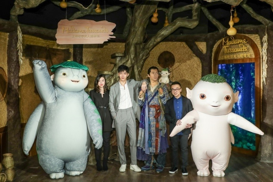 Jing Boran, MTSH brand-representative Ms. Sabrina Pan and Monster Hunt series director Raman Hui unveiled Monster Hunt 2 wax figures in the presence of Wuba and Benben