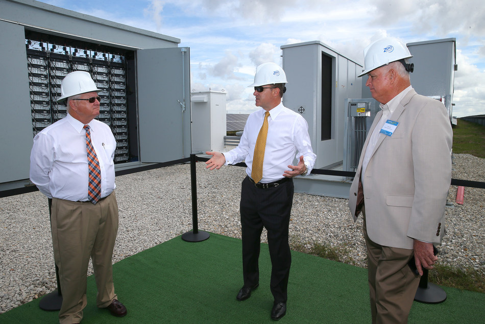 DeSoto County Commission Chairman Jim Selph (left), Florida Power & Light Company (FPL) President and CEO Eric Silagy and DeSoto County Commissioner Terry Hill discuss the company's new battery storage technology at the FPL Citrus Solar Energy Center in DeSoto County, Fla., Feb. 9, 2018. During the commissioning of the company's third and newest solar power plant in DeSoto County - FPL Wildflower Solar Energy Center - the company unveiled what is believed to be the country's first-of-its-kind solar-plus-battery storage system that increases the amount of energy a solar plant delivers to the grid. Photo credit: Alex Menendez for FPL.