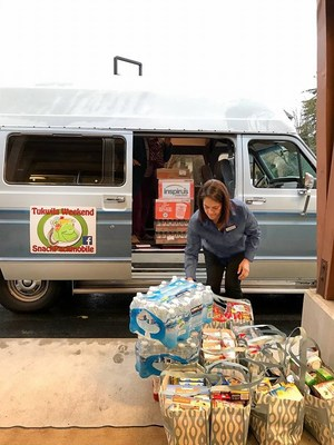 Local business partners load donated food items into the SnackPack mobile. 220 homeless students in the Tukwila School District receive weekend meals from the Tukwila Weekend SnackPack Program every Friday throughout the school year.