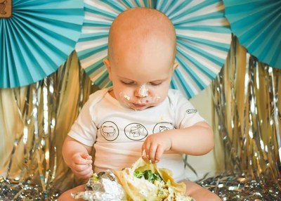 "The Burrito Baby | Sarah, Mark, Caleb & Jake | ""My husband knew early on of my love for Chipotle. Countless dates there, through dating and marriage. Then during my second pregnancy it was ALL I craved. He knows my order by heart, which is obviously the mark of true love. When our son celebrated his first birthday we HAD to have a Chipotle smash instead of a cake smash! Complete with the best onesie from the website. Our little burrito babe!"""
