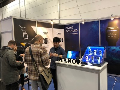 CYANO staff explaining the CYANO dive computer to the customers at the Boot Show in Messe Dusseldorf, Germany