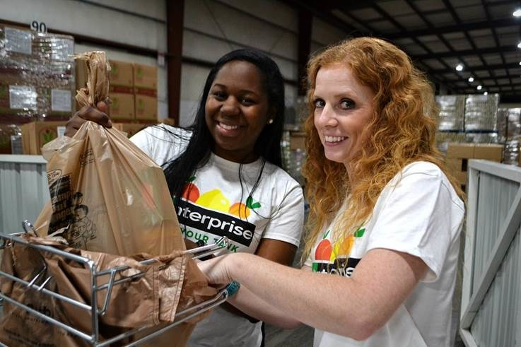 Enterprise employees volunteering at the Community Food Bank of Central Alabama.