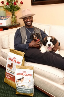 "Taye Diggs partners with Royal Canin to help dog lovers find their perfect breed match at the ""Chews Your Match"" event at the Sofitel in New York."