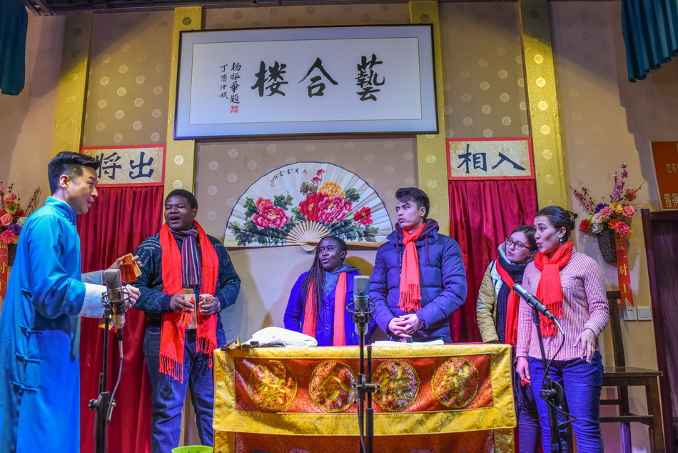 International students from Liaoning University welcomed the traditional Chinese Year of the Dog with locals.