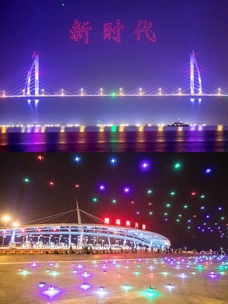 """The formation of unmanned aerial vehicles at the Hong Kong-Zhuhai-Macao Bridge. The red characters in the sky read """"New Era""""."""