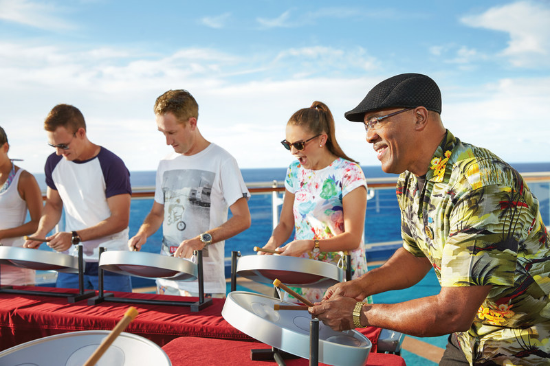 Millennials choose cruise vacations both for relaxation and new experiences, such as steel drum lessons on a Caribbean cruise.  Photo courtesy of Princess Cruises.