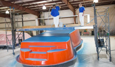 The production team at Thursday Pools creates a handcrafted fiberglass pool. Each layer is applied by hand.