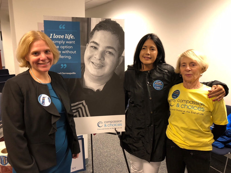 Compassion & Choices CEO Kim Callinan, photo of deceased medical aid-in-dying advocate Miguel Carrasquillo, Miguel's mother, Nilsa Cedeno and Compassion & Choices board member Samantha Sander