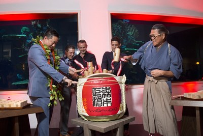 Morimoto Asia Waikiki General Manager Chase Heu, Alohilani Resort General Manager Matt Grauso, Highgate Vice President of Construction Paul McElroy, Highgate Principal Vann Avedisian and Iron Chef Morimoto participate in a traditional sake barrel ceremony as part of the grand opening festivities of Morimoto Asia Waikiki at Alohihani Resort Waikiki Beach.  The restaurant opens for dinner service to the public on February 15th.
