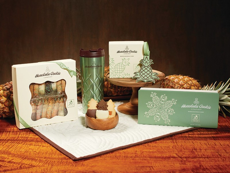 Family owned and operated Honolulu Cookie Company is marking its 20th anniversary with a special collection of cookie boxes, collectible tins, commemorative merchandise and of two new delectable signature flavors of its premium shortbread cookies, baked fresh daily in Hawaii.