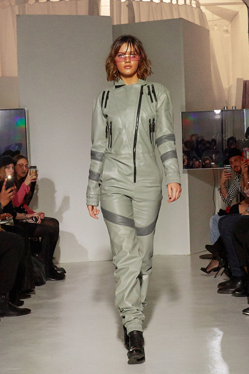 Singer Daisy Gray opens the runway for Bereshift at FTL MODA NYFW, after an outstanding vocal performance while playing the Grammy's baby white piano.