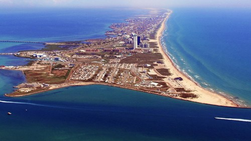 With 34 miles of beautiful white sand and clear emerald water,  South Padre Island is one of the world's most exquisite barrier islands and the only island in Texas.