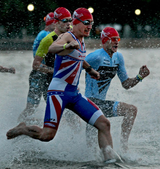 Athletes enter the water for the start of the St. Anthony's Triathlon last year. Photo courtesy of the St. Anthony's Triathlon