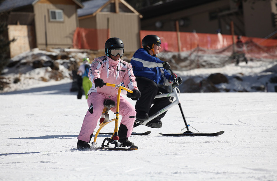 Wounded warriors use adaptive ski equipment to enjoy the joys of skiing during Snowbowl 2018.