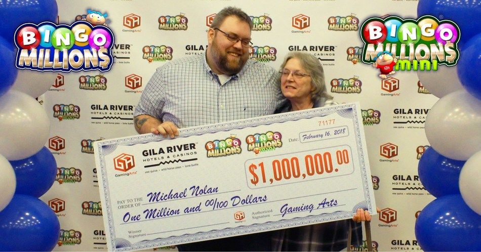 Michael Nolan and his mother receiving the big Bingo Millions® $1,000,000 check from Gaming Arts