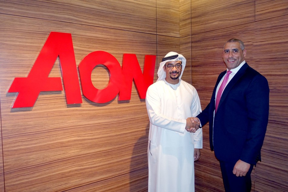 (From left to right) 'Abdulmuttalib (Talib) Hashim, Founder and Managing Director of TBH Consultancy with Chris Page, CEO, Talent, Rewards & Performance, Aon Middle East and Africa, entering a strategic partnership between the two companies to help develop and deliver strategies to increase Emiratization in the Private Sector. (PRNewsfoto/Aon)