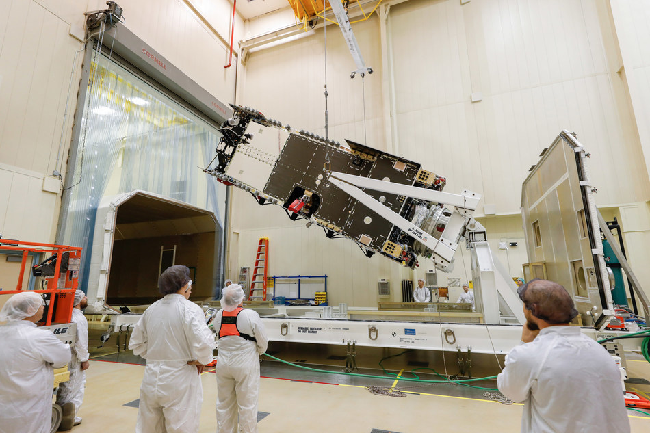 Technicians at Lockheed Martin prepare the Arabsat-6A satellite for shipment to Sunnyvale, California for testing.