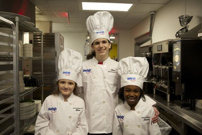 The first IHOP Kid Culinary Team visits the IHOP Test Kitchen Friday, February 16 to cook their own pancake creations alongside Chef Nevielle Panthaky, VP of Culinary, IHOP (from left: Elise Bromund, 8, Sim Scott, 15, Starla Chapman, 9.)
