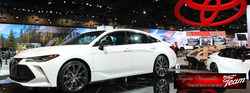 A white 2019 Toyota Avalon proudly on display at the 2018 Chicago Auto Show