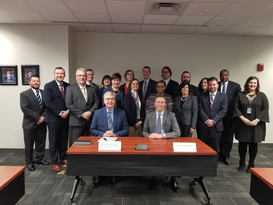 Ohio Department of Higher Education Chancellor John Carey and WGU President Scott Pulsipher are joined by representatives from their respect organizations at the signing of approval documents for Western Governors University that authorizes the nonprofit university to establish WGU Ohio.