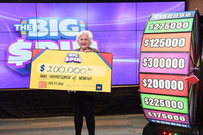 Anne Hammerschmidt of Windsor celebrates after spinning THE BIG SPIN Wheel at the OLG Prize Centre in Toronto to win $200,000. Hammerschmidt won a top prize with OLG's INSTANT game – THE BIG SPIN. (CNW Group/OLG Winners)