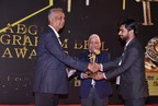 Dev Kumar receiving Graham Bell Award (PRNewsfoto/Neron Informatics Pvt. Ltd)