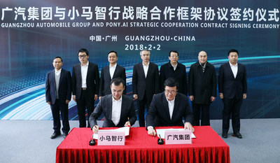 Pony.ai COO Harry Hu and GAC Group Deputy General Manager Song Wu sign a strategic partnership agreement with leadership from Pony.ai, GAC Group, and the Nansha government.
