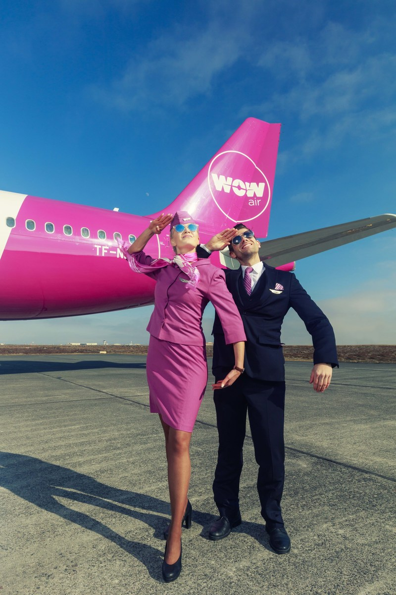 WOW air crew members outside the iconic purple WOW air aircraft.