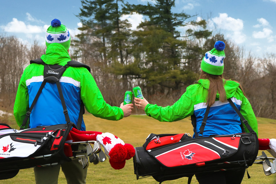 Two golfers cheers to the new partnership between Golf Canada and Steam Whislte. (CNW Group/Golf Canada)