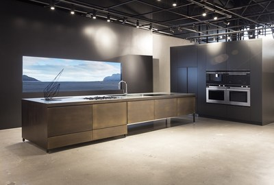 Hero kitchen island in the Costa Mesa Experience Center. Photography Credit: Chloe Crespi
