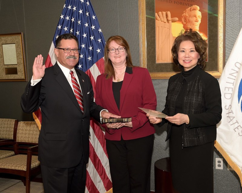 U.S. Secretary of Transportation Elaine L. Chao swears in Raymond P. Martinez as Administrator of the Federal Motor Carriers Safety Administration. From left: Raymond Martinez, his wife Marin Gibson and Secretary Elaine L. Chao.