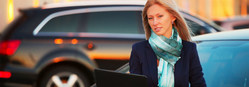 woman researching car models on her laptop.