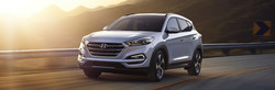 Driver side exterior view of a gray 2018 Hyundai Tucson.