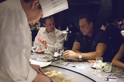 "Mark Frissora, President and Chief Executive Officer, and Eric Hession, Chief Financial Officer, and other Caesars Entertainment senior management team members experienced the Japanese iron griddle cooked cuisine ""Teppanyaki"" in Tokyo. (PRNewsfoto/Caesars Entertainment ...)"