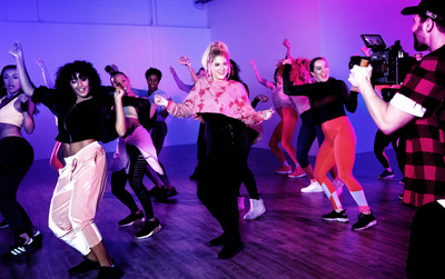 The multi-platinum Trainor, dancing alongside an all-female ensemble, is the first recording artist to star in an official Zumba choreography video.