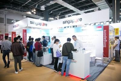 Visitors communicating with Singapore exhibitors at Medtec China 2017