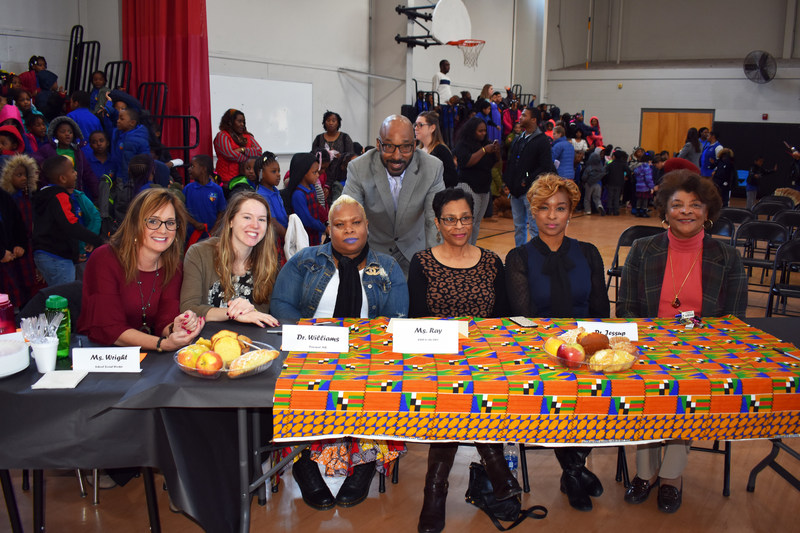 Judges for the Chester Community Charter School (CCCS) kindergarten and first-grade Oratorical Contest included (front row, seated, from left):Stephanie Wright, student service coordinator; Susanne Cianfaro, student service coordinator/social worker; Dr.Kwame Williams, principal, Freedom Hall; Ms. Annette Ray, executive assistant; Dr. Belinda Jessup, director, Literacy, and Dr. Linda Portlock, deputy superintendent. Dr. David Clark, CCCS, CEO is shown standing, center.