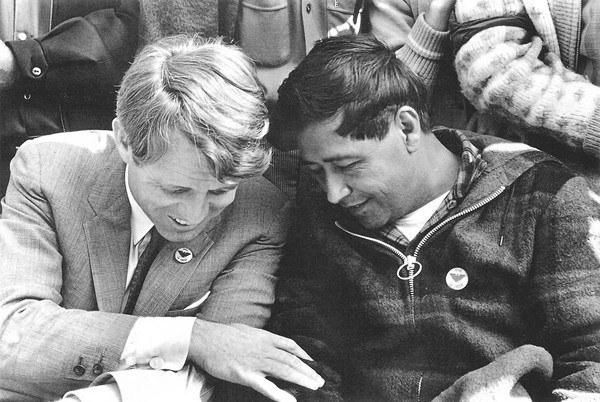 Nearly 50 years ago on March 10, 1968, Cesar Chavez's 25-day, water-only fast to rededicate the grape strikers to nonviolence ended during an outdoor Catholic mass at a Delano park attended by thousands of farm workers and supporters. A weakened Chavez, who had lost 35 pounds, was joined by U.S. Senator Robert F. Kennedy just five days before he announced his presidential candidacy and three months before the senator's assassination. Photo credit: George Ballis - Take Stock