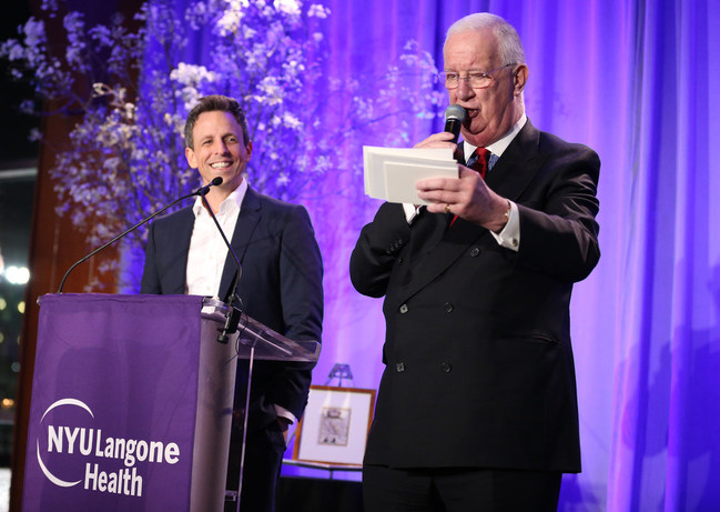 C. Hugh Hildesley and Seth Meyers during the live auction at the 2018 FACES Gala.
