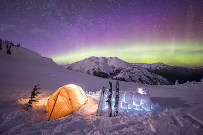 Photo credit: Eric Poulin - The aurora borealis dances over a campsite on Mount Sproatt near Whistler, B.C. (CNW Group/Royal Canadian Geographical Society)