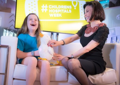Chloe Davison, a 10-year-old from Grants Pass, Ore. who was diagnosed with Leukemia at age 5, smiles joyfully as Catherine Hernandez-Blades, SVP and Chief Brand and Communications Officer at Aflac, introduces her to My Special Aflac DuckTM – a robotic caring companion designed to help children cope with cancer, while in Orlando, Fla. celebrating Children's Miracle Network Hospitals'  #ChildrensHospitalsWeek. To learn more about how Aflac and CMN Hospitals are helping children with cancer, visit aflac.com/cmn.