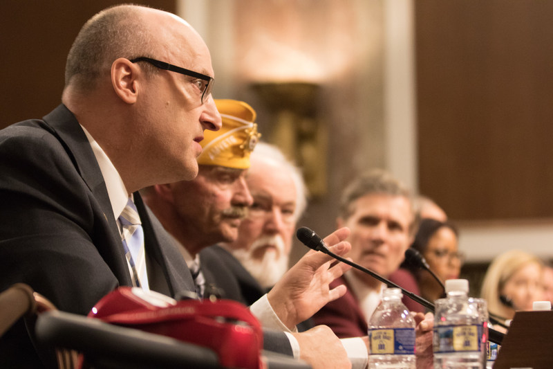 Paralyzed Veterans' National President, David Zurfluh (foreground), delivering the organization's annual testimony before the House and Senate Committees on Veterans' Affairs