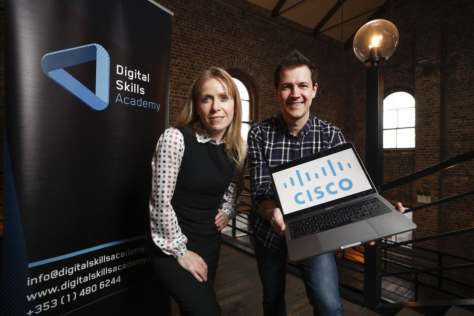 From left to right, Karen O'Grady, Corporate Account Manager at Digital Skills Academy, and Christos Koutsiaris, Senior JavaScript Developer at SAP Ireland and Digital Skills Academy Graduate. (PRNewsfoto/Digital Skills Academy)