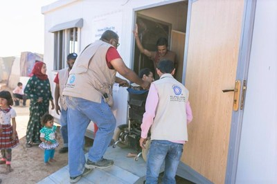 Helping Hand for Relief and Development (HHRD) team taking a new Syrian Refugee family into an HHRD Shelter Home for Syrian Refugees. This family has a child with disability.