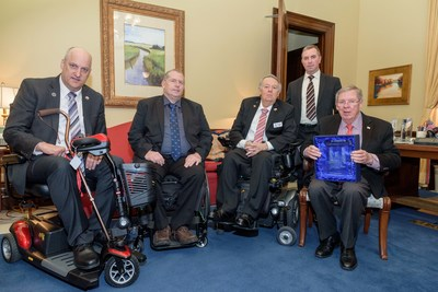 Senator Johnny Isakson (far right) receives 2018 Gordon H. Mansfield Congressional Leadership Award from Paralyzed Veterans of America. (L-R) David Zurfluh, Paralyzed Veterans' National President; Paul Stewart, National Director, Southeastern Chapter; Larry Dodson, Paralyzed Veterans' National Secretary; and Carl Blake, Paralyzed Veterans' Executive Director (standing)