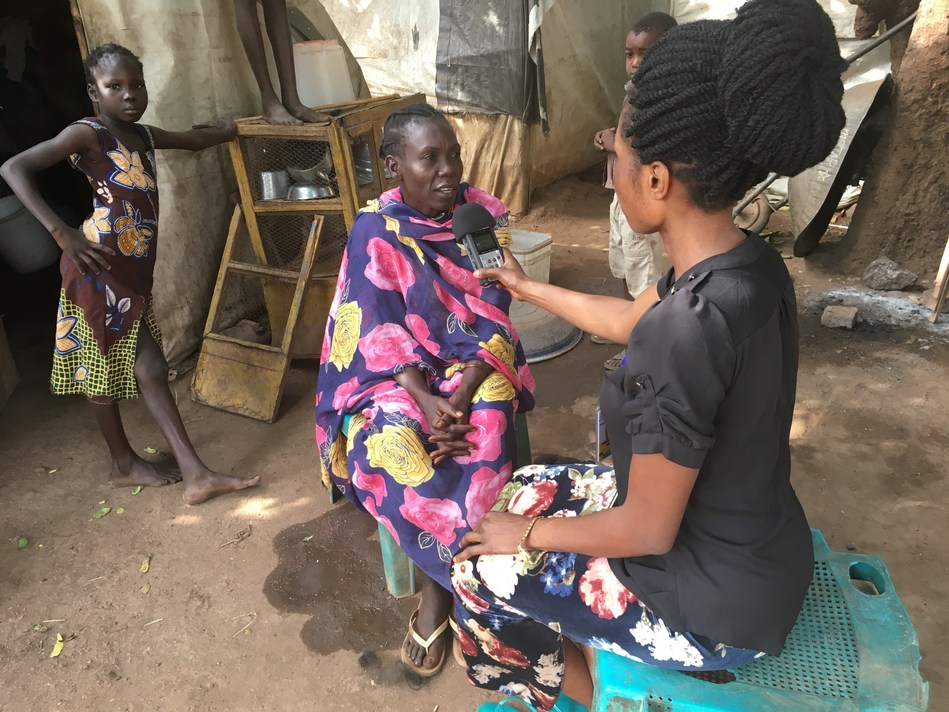 Photo credit Laura Bain. JHR journalism trainee interviewing Internally Displaced Persons in Wau, South Sudan (CNW Group/Journalists for Human Rights (JHR))
